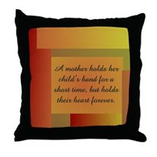 A MOTHER HOLDS HER CHILD'S HA Throw Pillow