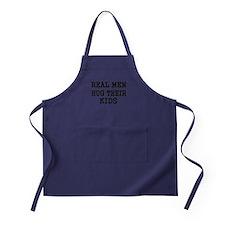 REAL MEN HUG THEIR KIDS Apron (dark)