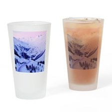 Snowy sunset over mountains Drinking Glass