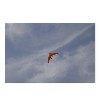 a hang gliders soars overhead