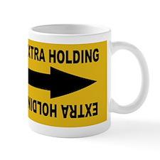 extra holding Mug
