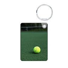 Tennis ball on green court Aluminum Photo Keychain