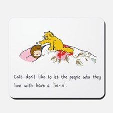 Cats don't like to let people 'lie in'. Mousepad
