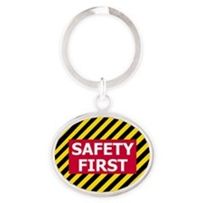 3-Safety-First-Tile.gif Oval Keychain