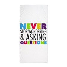 Never Stop Wondering Beach Towel