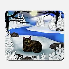 Tortoiseshell cat frozen river Mousepad