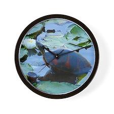 Florida Redbelly Turtle between trash a Wall Clock