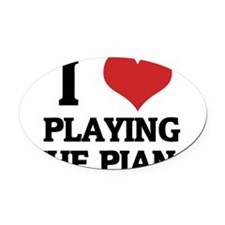 PLAYING THE PIANO Oval Car Magnet