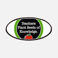 Teachers plant seeds Patches