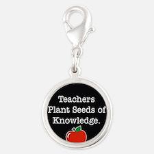Teachers plant seeds Charms