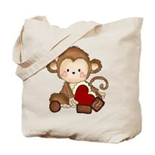 Monkey with candy Tote Bag