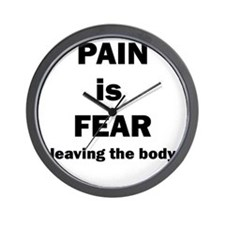 Pain is fear leaving the body Wall Clock