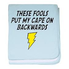 THESE FOOLS PUT MY CAPE ON BACKWARDS BIB baby blan