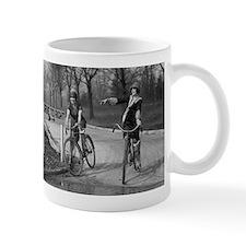 Flapper Girls Riding Bicycles Mugs