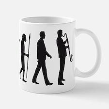 evolution of man bass clarinet player Mugs