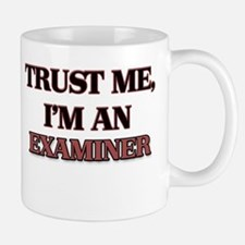 Trust Me, I'm an Examiner Mugs