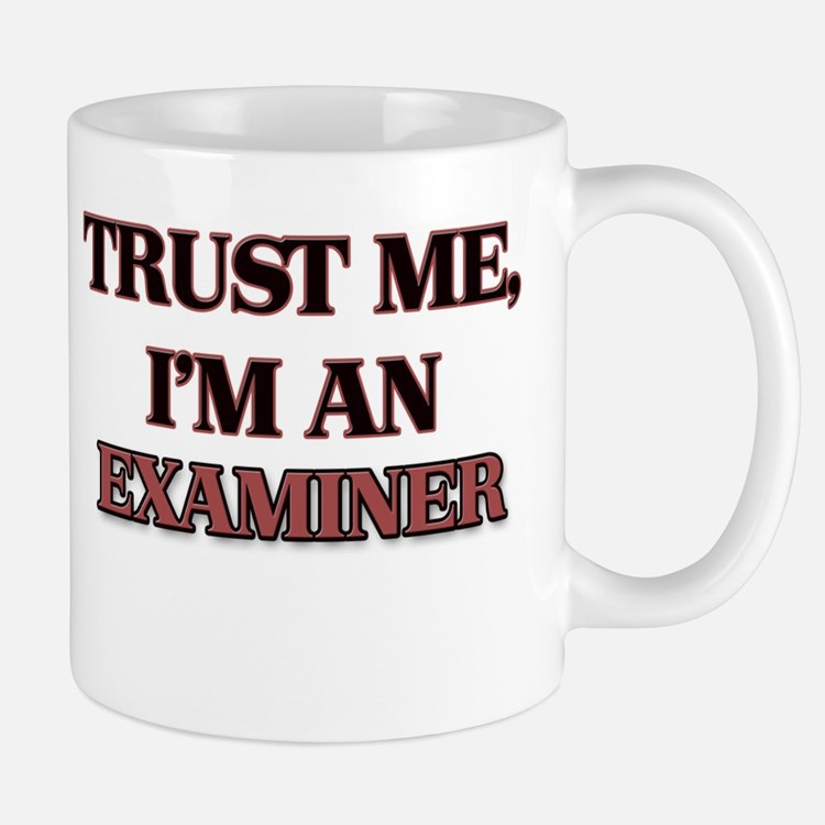 Trust Me, I'm an Examiner Mugs