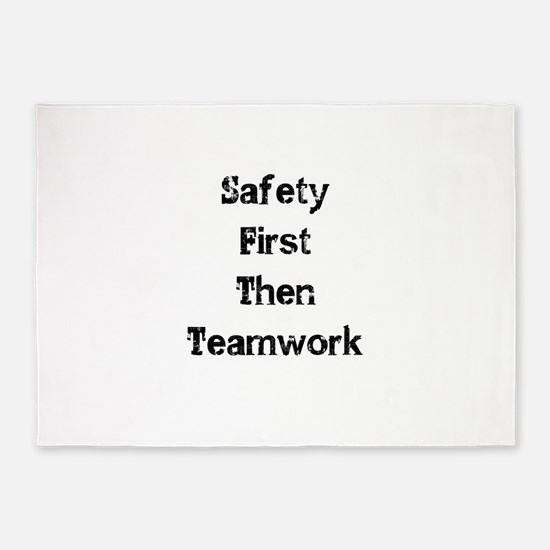 Safety First Then Teamwork 5'x7'Area Rug