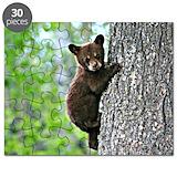 Bear cub climbing a tree Puzzles