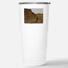 Forward Operator gazes across a Travel Mug