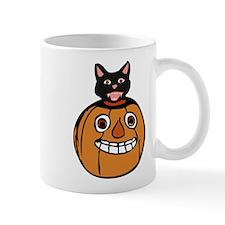 cartoon halloween pumpkin with a black cat Mugs