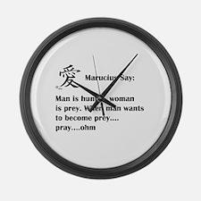 Man is hunter, woman is prey Large Wall Clock
