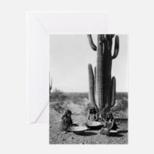 Three Maricopa Indians, seated in front of cactus,