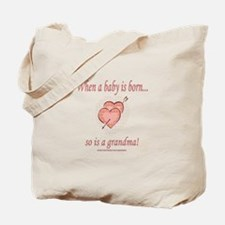 When A Baby Is Born... Tote Bag