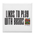 Likes To Play With Beads Tile Coaster