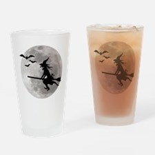 Halloween witch with a cat flies on Drinking Glass