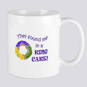FOUND ME IN A KING CAKE Mugs