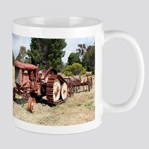 Old rusty tractor in the country Mugs