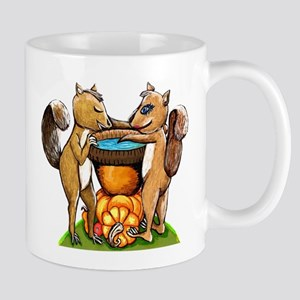 Squirrels In Love at a nut cap birdbath Mugs