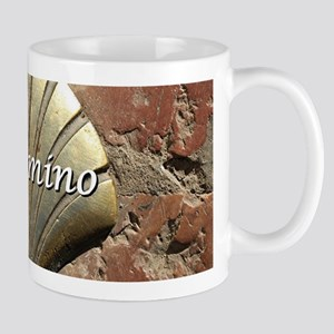 El Camino gold shell, Leon,Spain (caption) Mugs