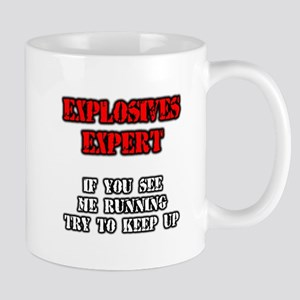 EXPLOSIVES EXPERT. TRY TO KEEP UP Mugs