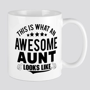 THIS IS WHAT AN AWESOME AUNT LOOKS LIKE Mugs