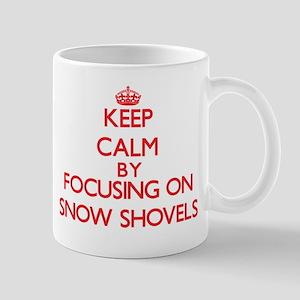Keep Calm by focusing on Snow Shovels Mugs