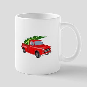 Bringing Tree Home Mugs