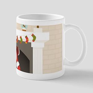 black santa stuck in fireplace Mugs