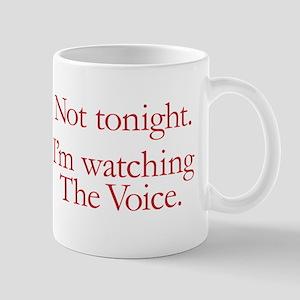Not tonight. I'm watching The Voice. Mug