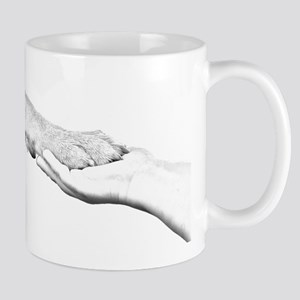 dog paw and human hand Mugs