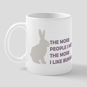 THE MORE PEOPLE I MEET THE MO Mug