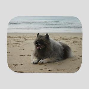 keeshond on beach ls Burp Cloth