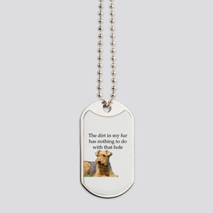 Airedale Sees no connection between his h Dog Tags