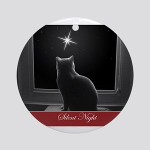 British Shorthair Gazing at Christmas Star Ornamen
