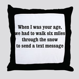 texting thru the snow Throw Pillow