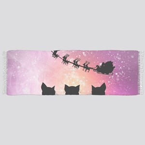 Cats looking in the sky to Santa Claus in the nigh
