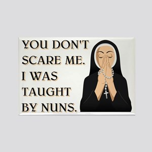 TAUGHT BY NUNS Rectangle Magnet