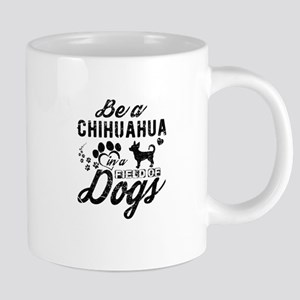 Chihuahua in a field of dogs Mugs