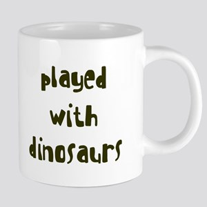 PLAYED DINOSAURS Mugs